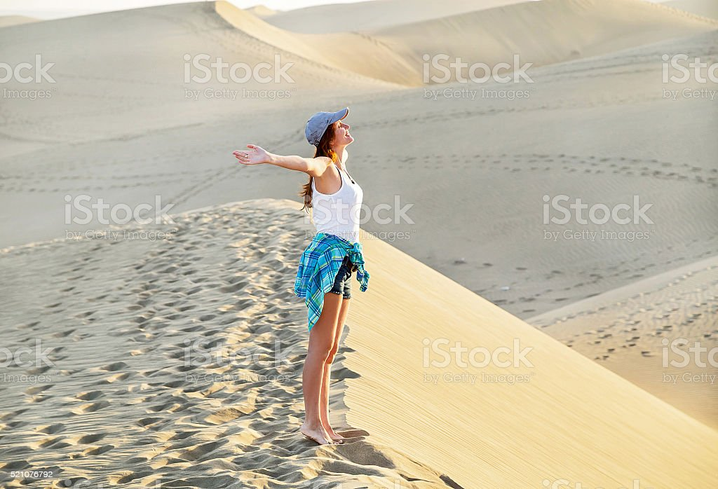 Free young woman in Maspalomas beach. Inspirational dunes. Spain. stock photo