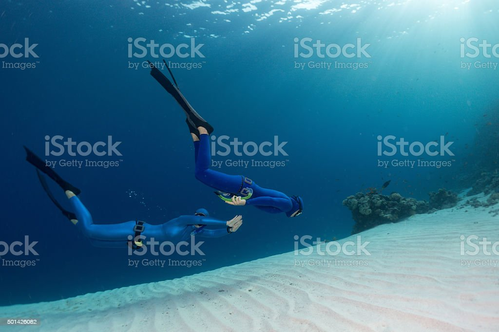 Freedivers in the sea stock photo