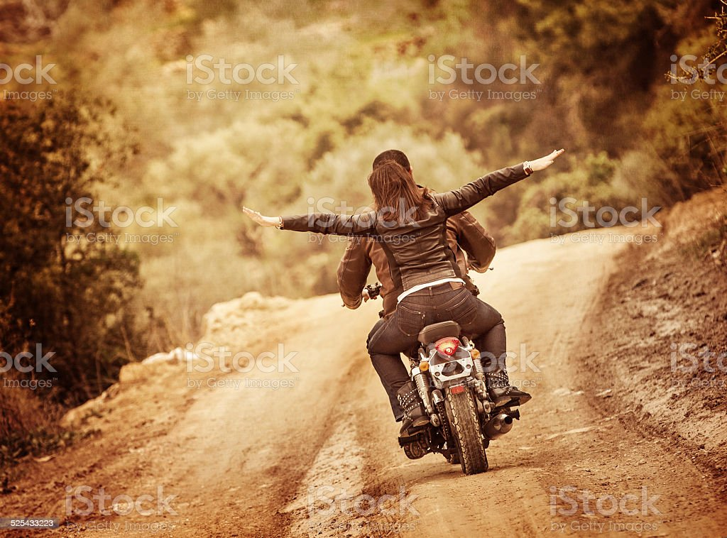 Sporty family traveling on motorbike, riding on motorcycle with...