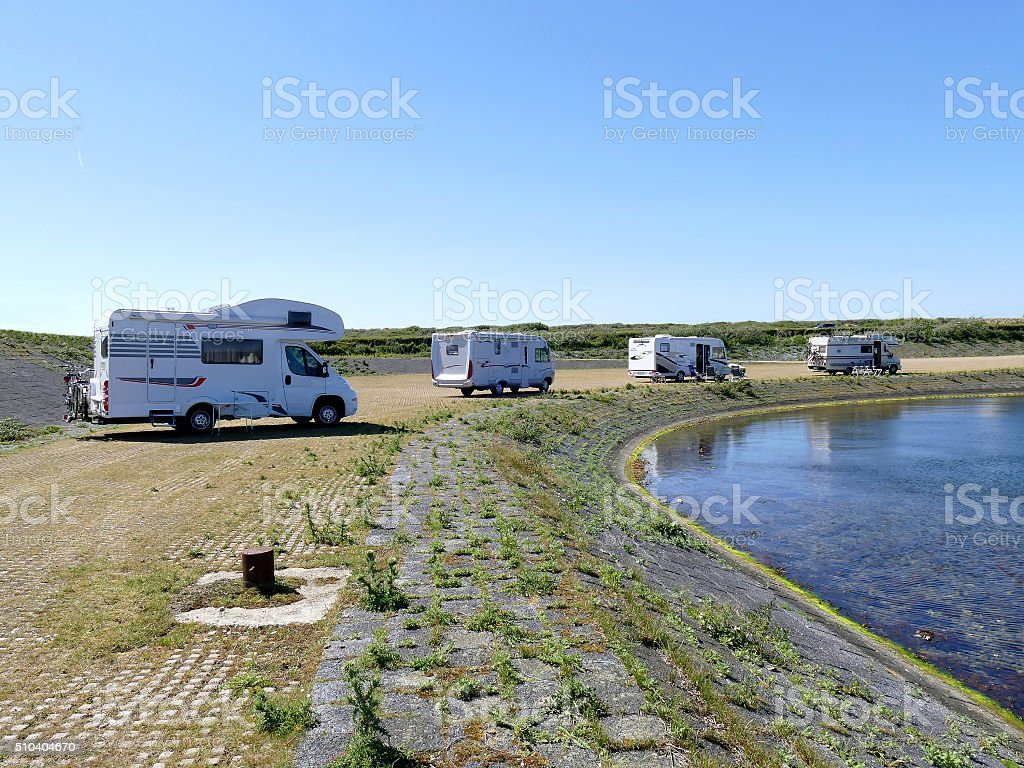 Freedom camping with camper motor homes at small lake stock photo