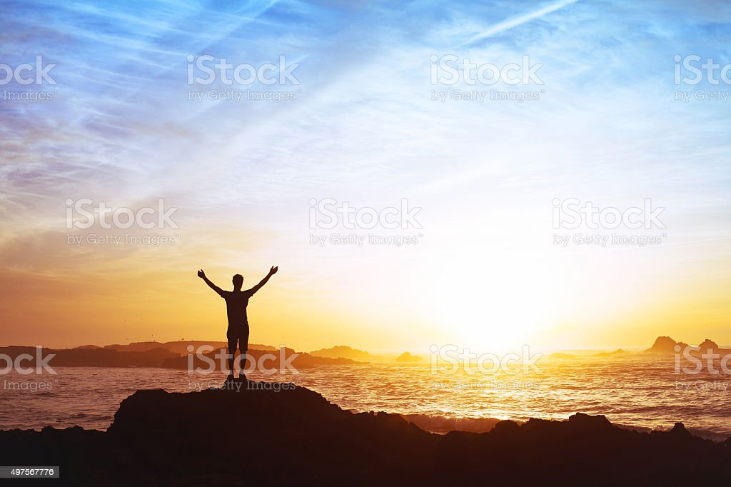 freedom concept, man with raised hands, silhouette stock photo