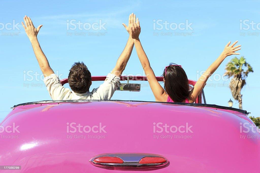 Freedom - happy free couple in car stock photo
