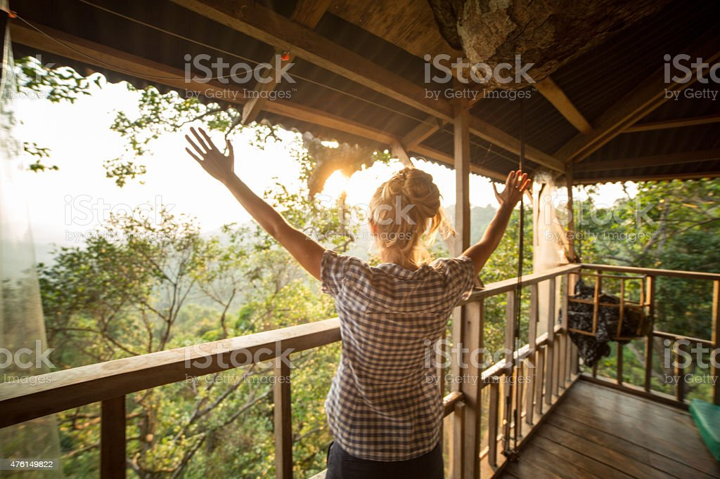 Freedom in nature-Woman arms raised stock photo