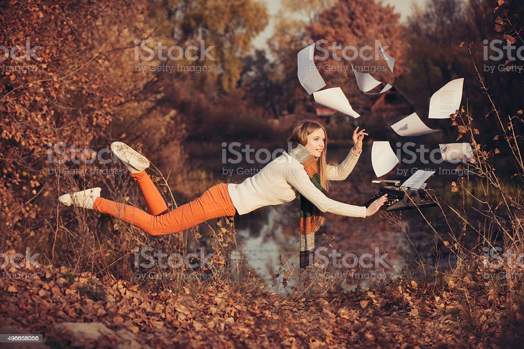 Freedom in the work. Woman levitation in the nature stock photo