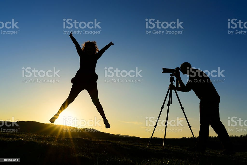 freedom jump silhouette stock photo