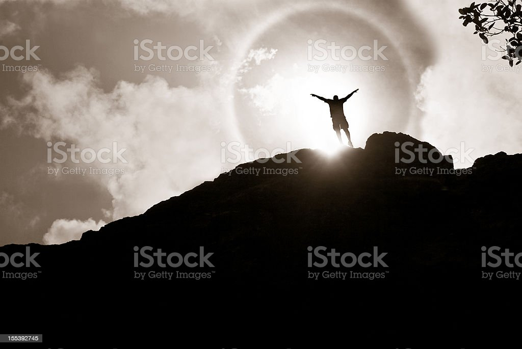 freedom morning; mountain man with arms raised royalty-free stock photo