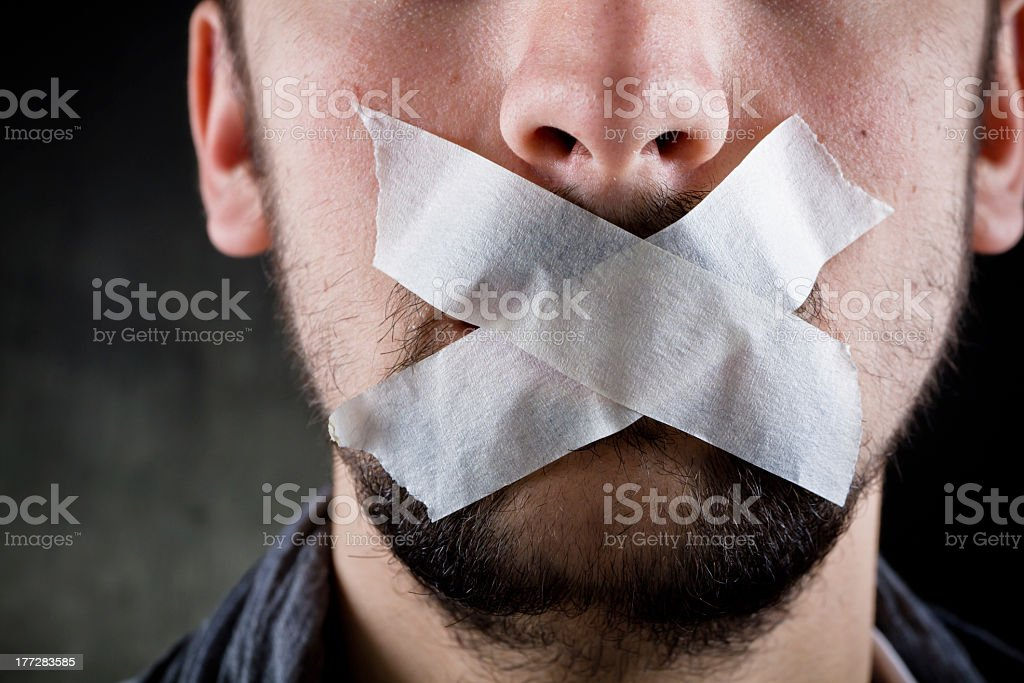 Freedom of speech with tape over a guy's mouth stock photo