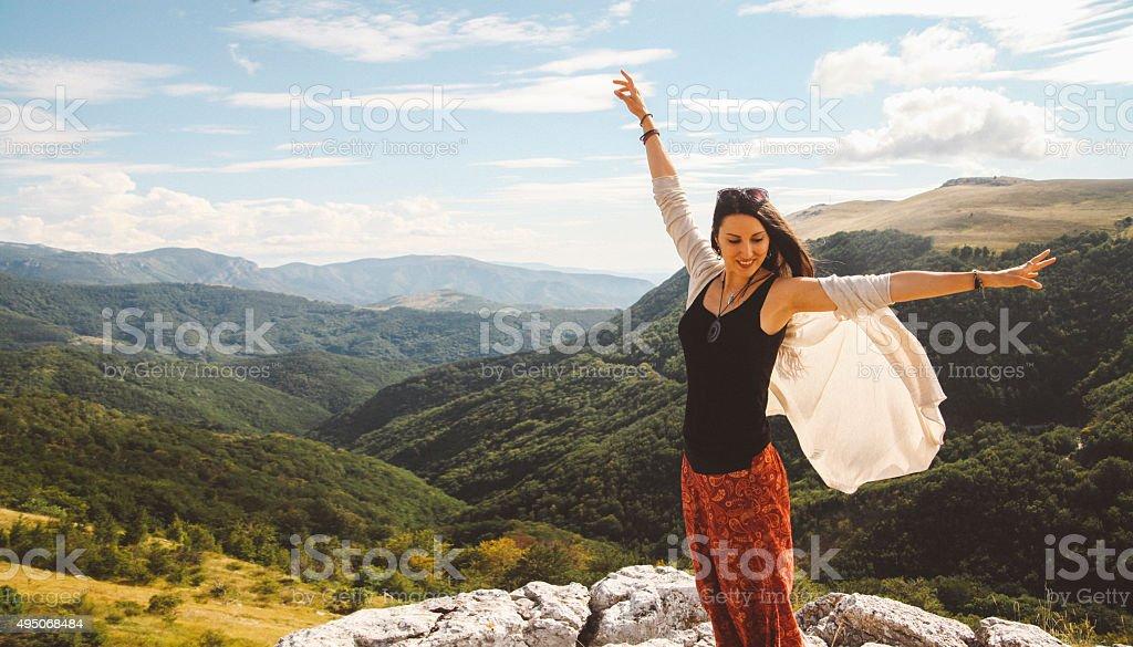 Freedom on top of the mountain range stock photo
