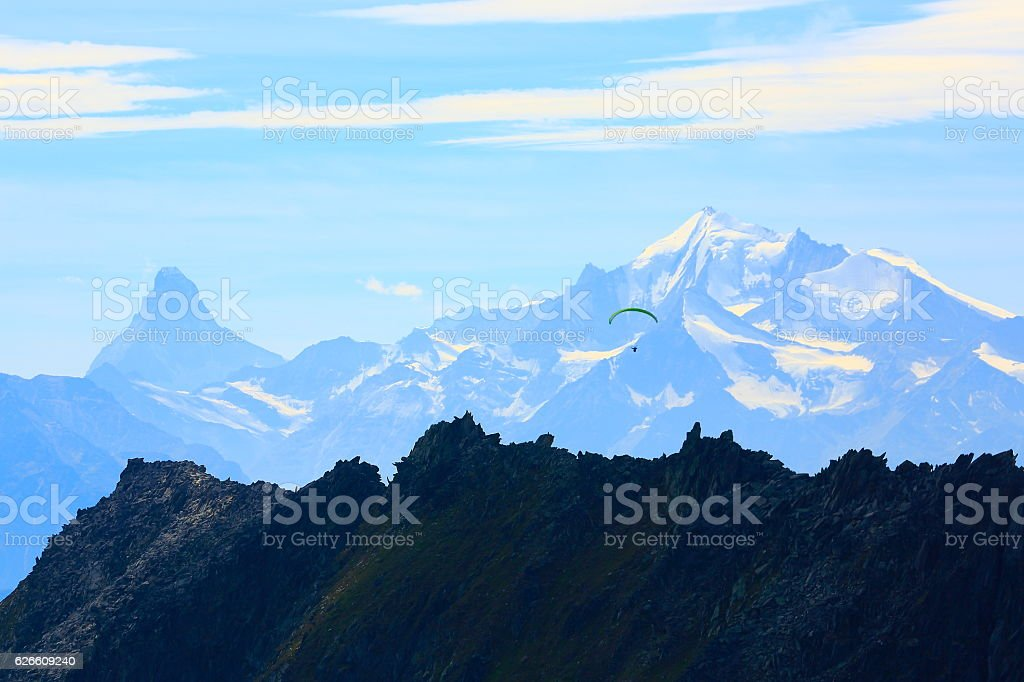 freedom: Paragliding above Matterhorn and Weisshorn alpine massif, Swiss Alps stock photo