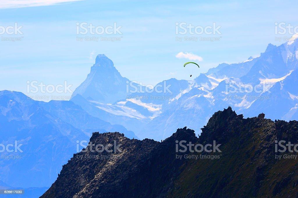 freedom: Paragliding above Matterhorn and Weisshorn alpine massif, Swiss Alps stock photo