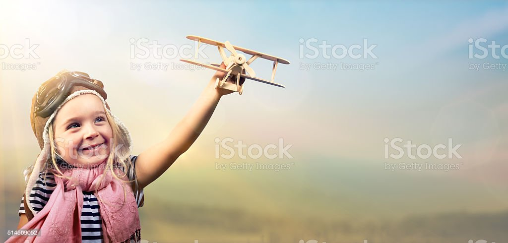Freedom To Dream - Kid With Airplane stock photo