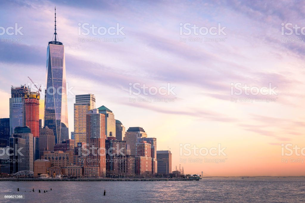 Freedom Tower and Lower Manhattan in the evening stock photo