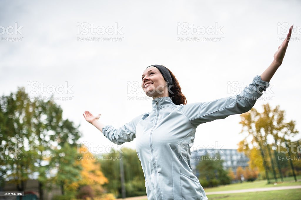 freedom woman doing yoga in the park stock photo