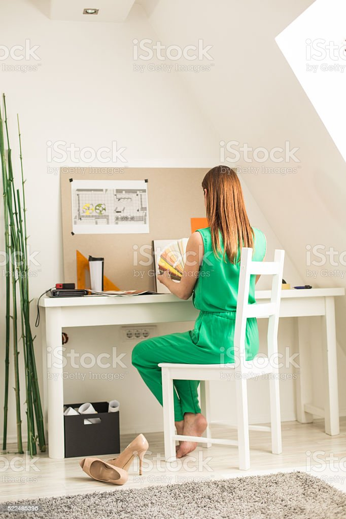 Freelance designer working at home office stock photo