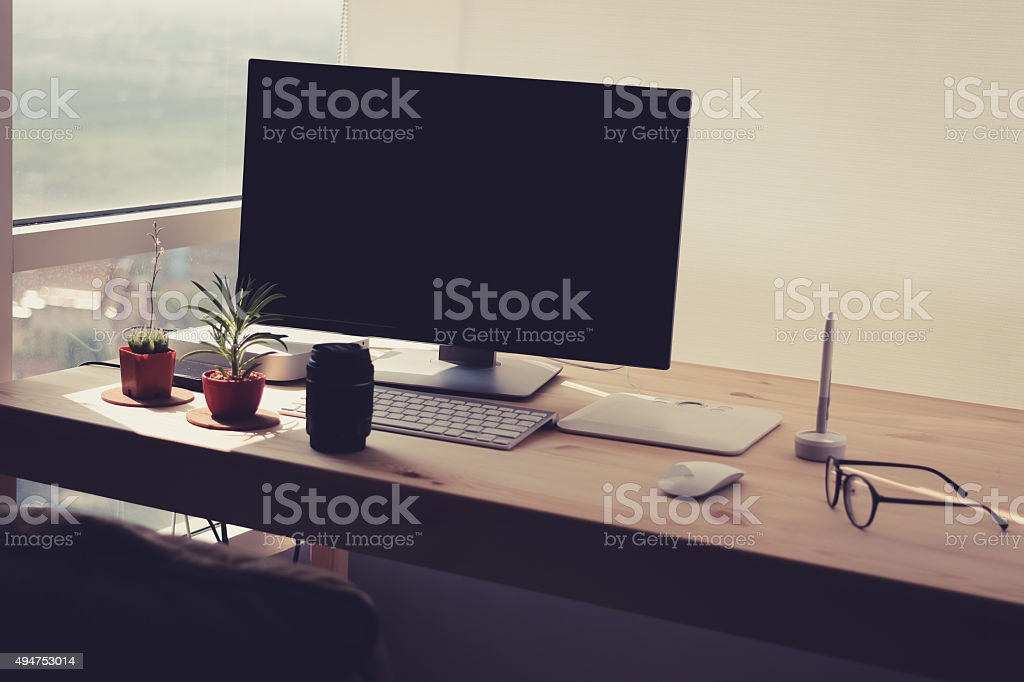 Freelance desk with potted plant. stock photo
