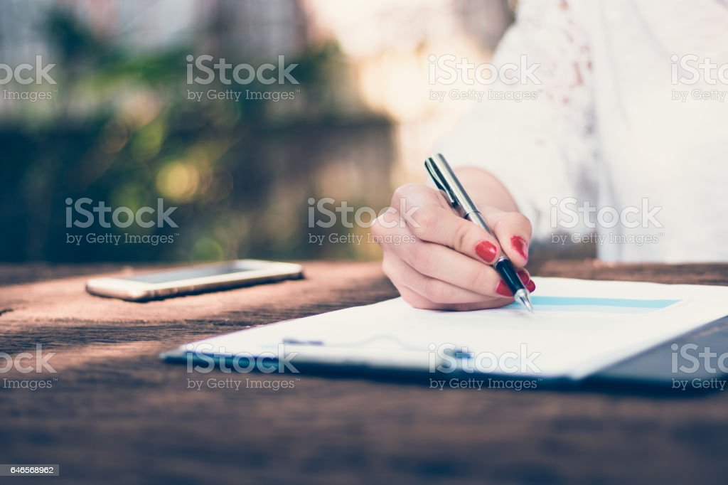 Freelance woman worked at the park. stock photo