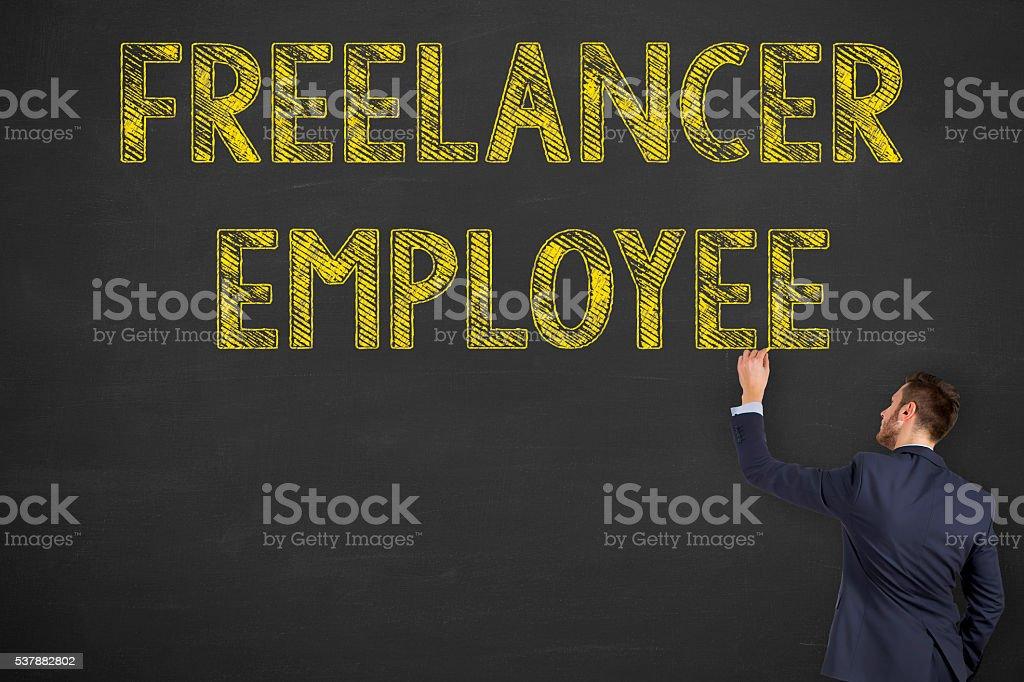 Freelancer Employee Writing on Blackboard Background stock photo