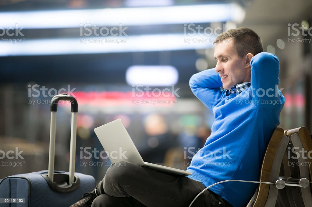 Freelancer traveler going on holidays stock photo