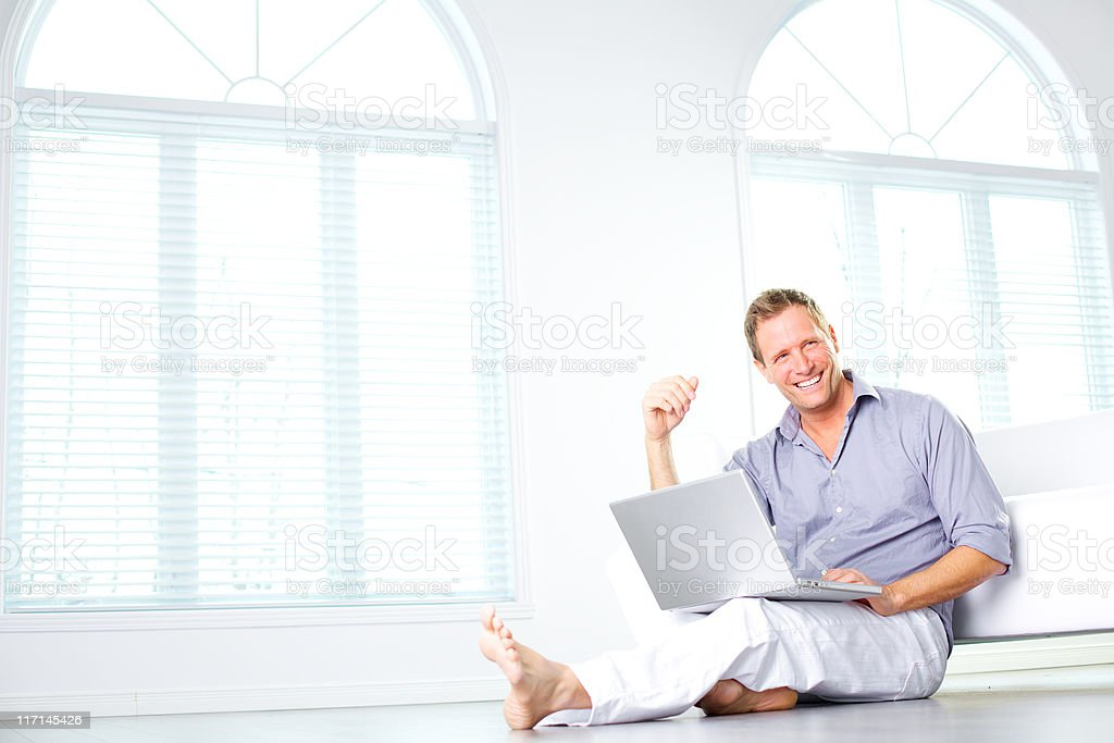 freelancer using a laptop looking at the camera royalty-free stock photo
