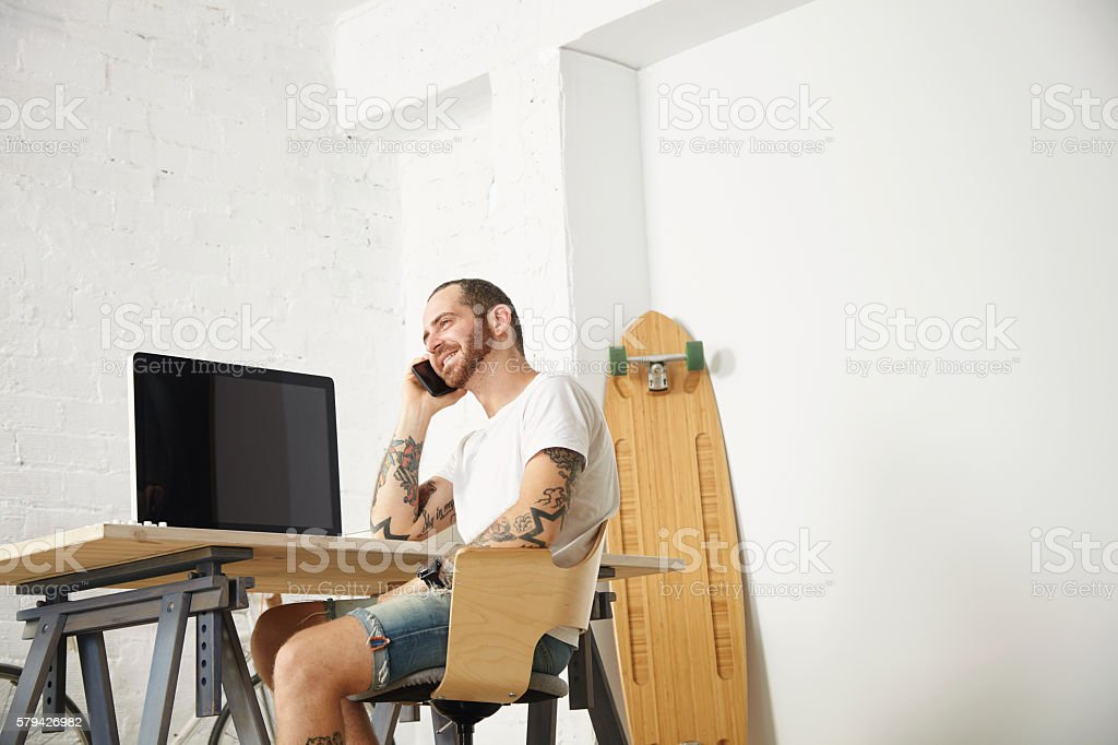 Freelancer with many hobbies working at home set stock photo