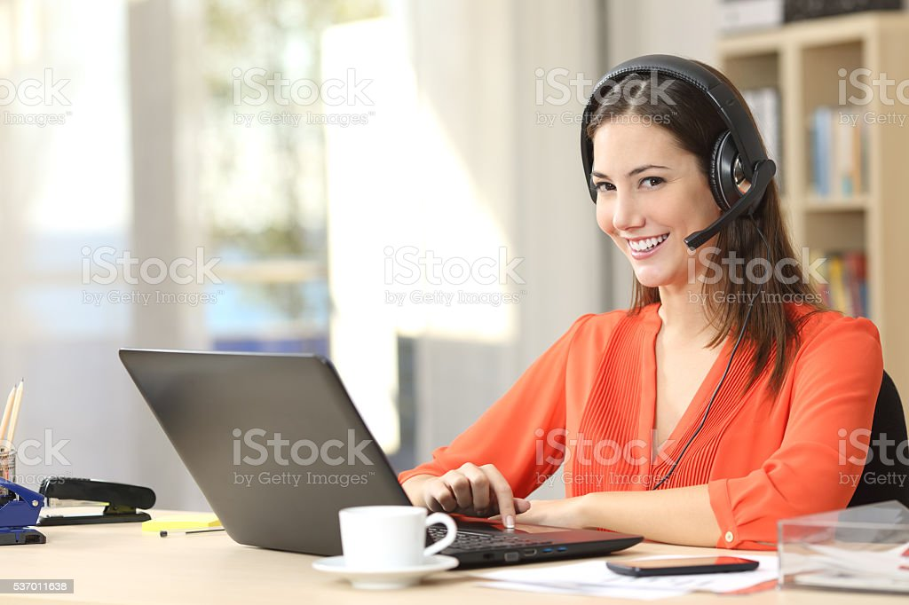 Freelancer working and looking at camera stock photo