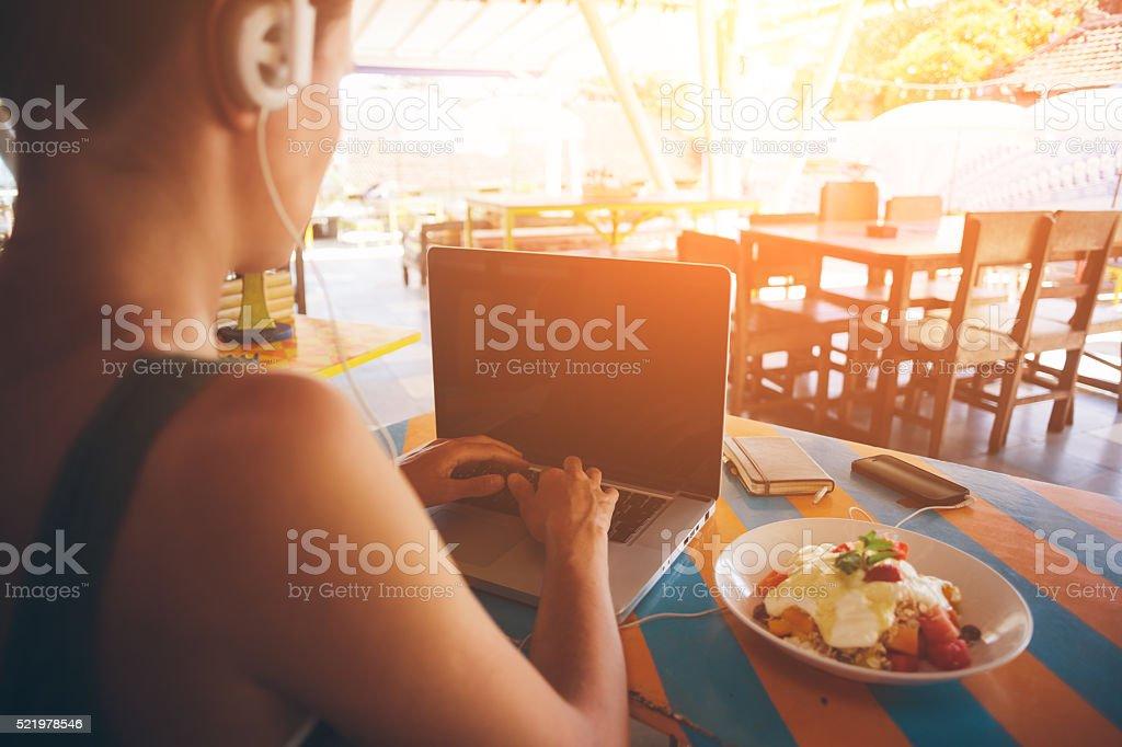 Freelancer working at laptop stock photo
