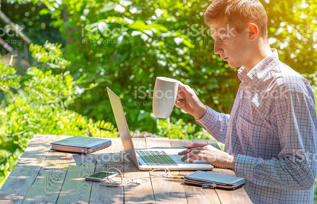 Freelancer working in park stock photo