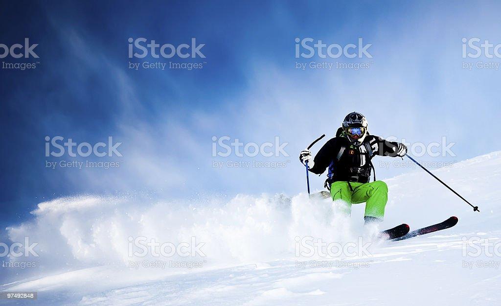 Freeride skier in powder snow