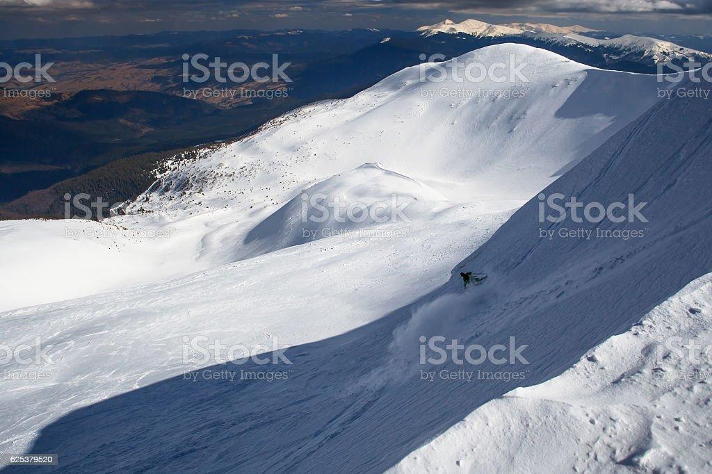 Freeride skier rides in winter mountains stock photo