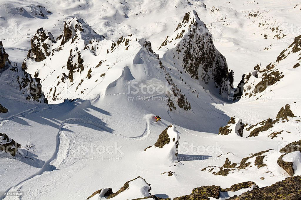 Free-rider making spectacular descent in the mountain stock photo