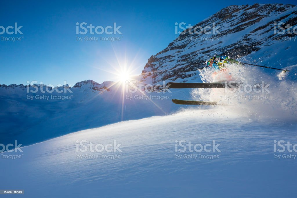 Freerider skier jumping in fresh powder snow stock photo