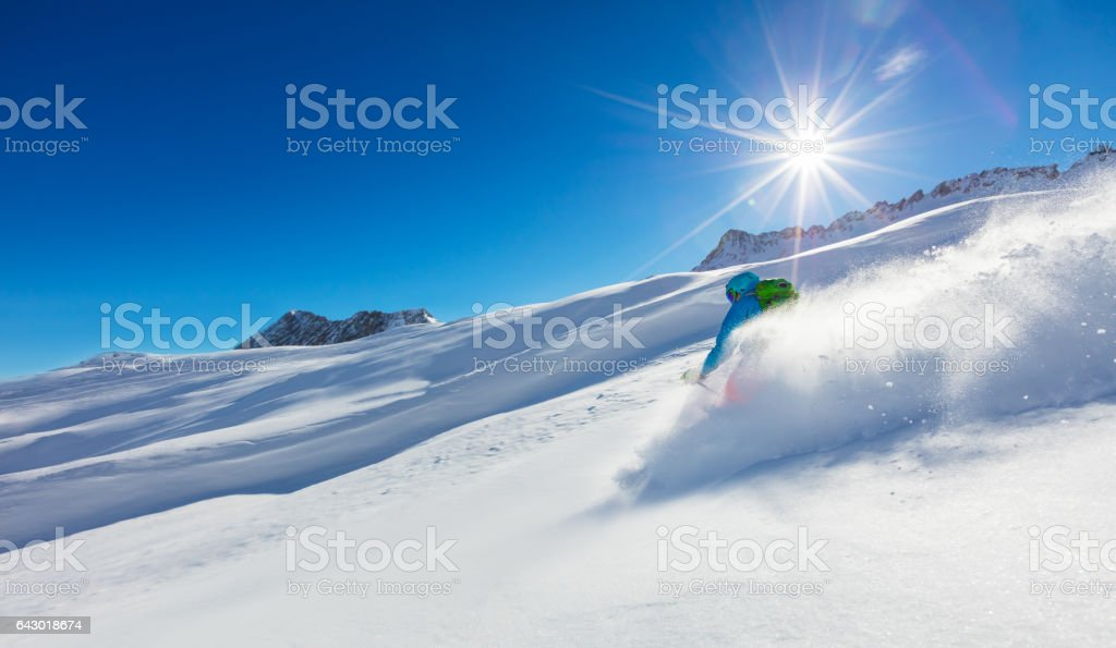 Freerider skier running downhill stock photo
