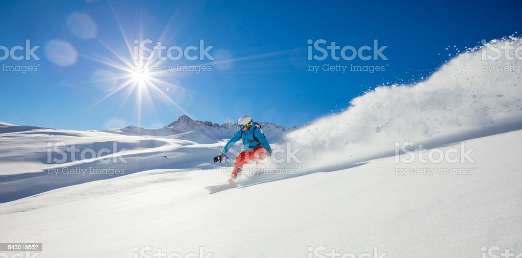 Freerider snowboarder running downhill stock photo