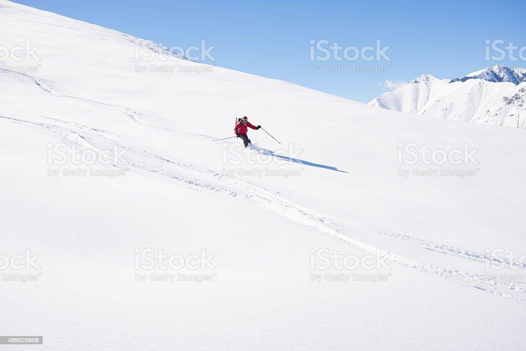 Freeriding on fresh powder snow stock photo