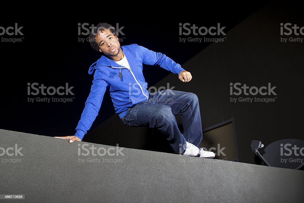 Freerunner Climbing a Wall At Night to Do Parkour royalty-free stock photo