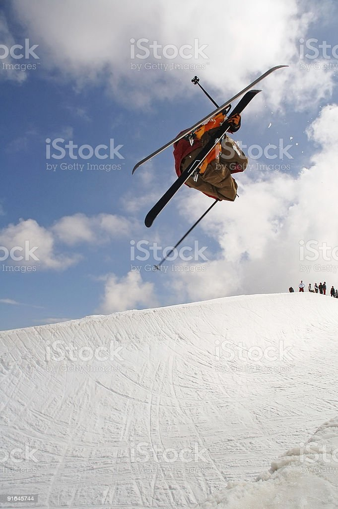 freeskier jumping in a halfpipe stock photo