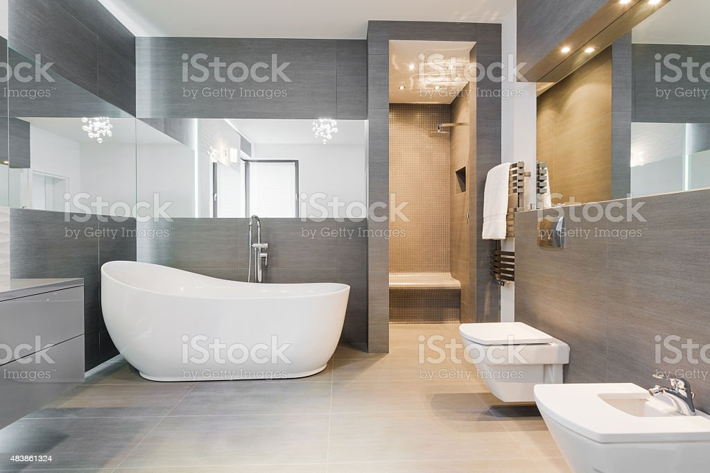 Freestanding bath in modern bathroom stock photo