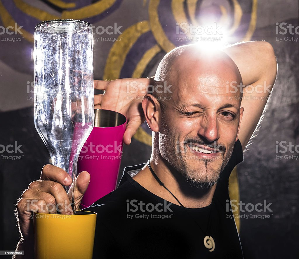 Freestyle American Bartender - Two colored Shakers and Bottle stock photo