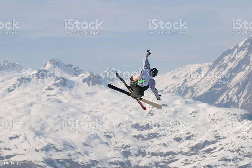 A freestyle skier floating in the air in Les Arcs, France stock photo