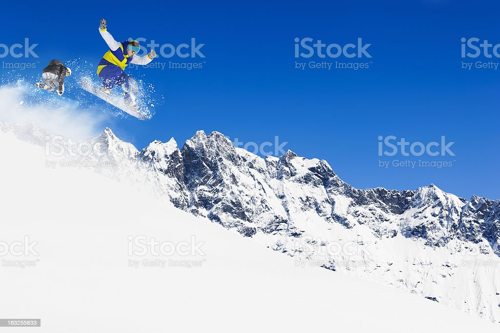 Freestyle snowboarder in a jump royalty-free stock photo