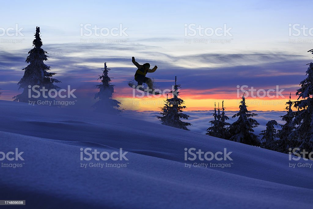 Freestyle snowboarder in a jump stock photo