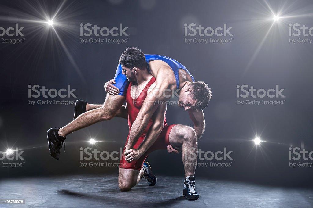 Freestyle wrestler throwing stock photo