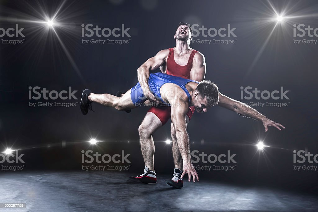 Freestyle wrestler throwing stock photo