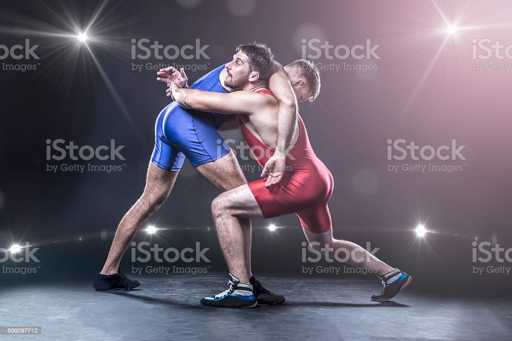 Freestyle wrestlers in action stock photo