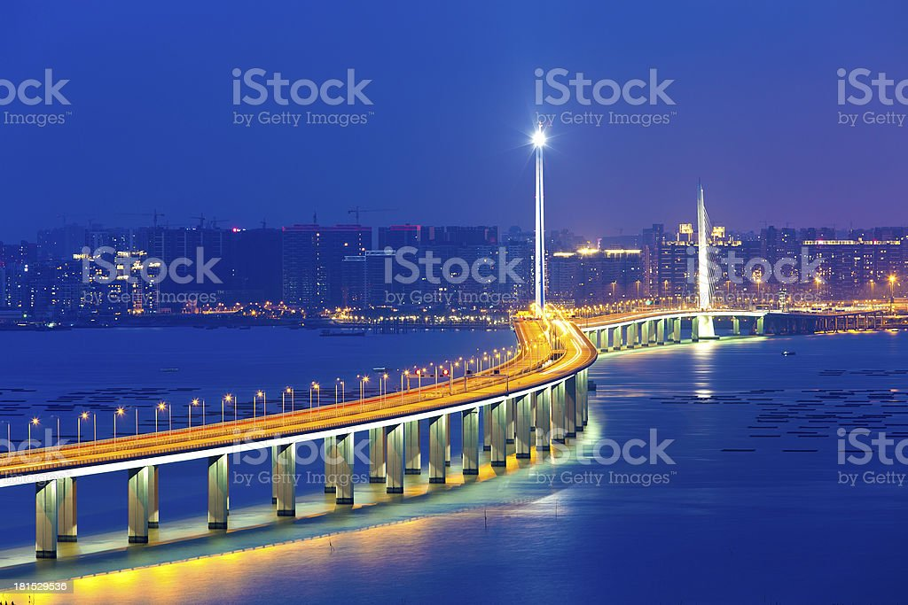 Freeway at night with moving cars royalty-free stock photo