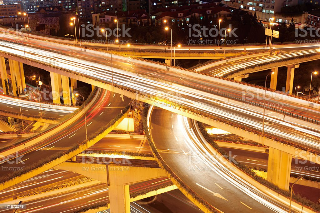 Freeway interchange, heavy traffic at night. stock photo