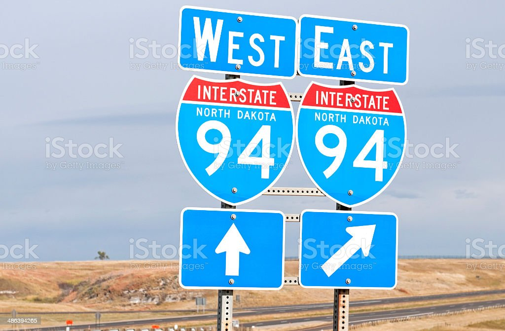Freeway signs indicating directions on I-94 in North Dakota stock photo