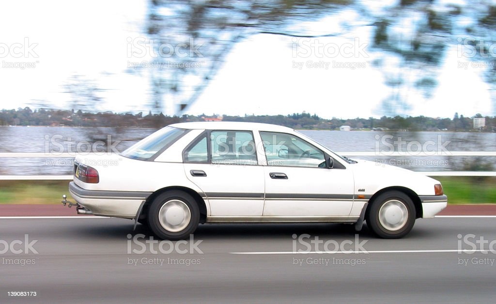 freeway - white sedan royalty-free stock photo