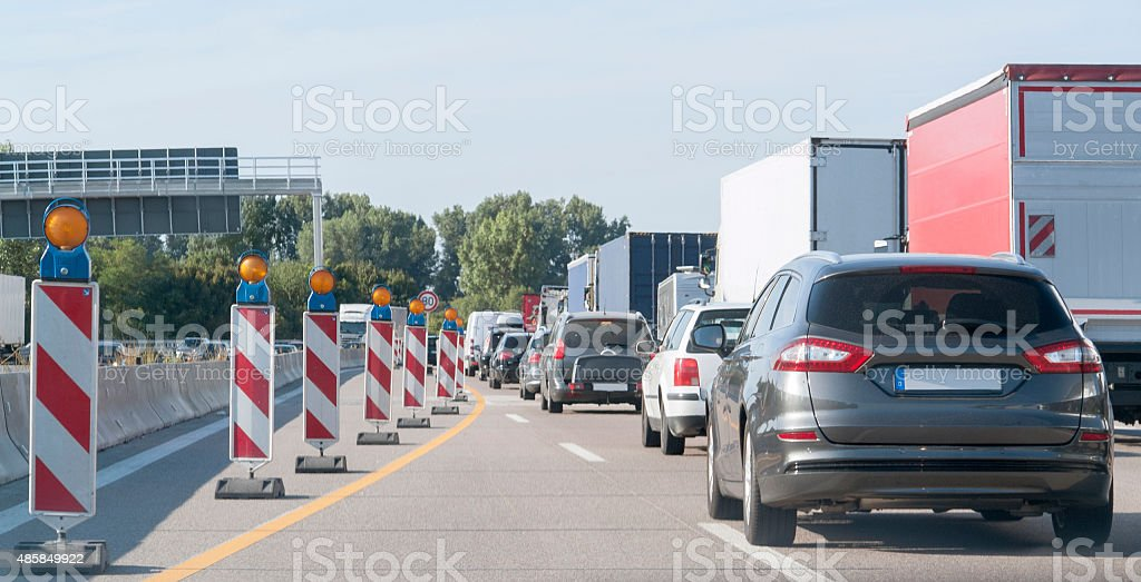freeway with building lot and traffic jam stock photo