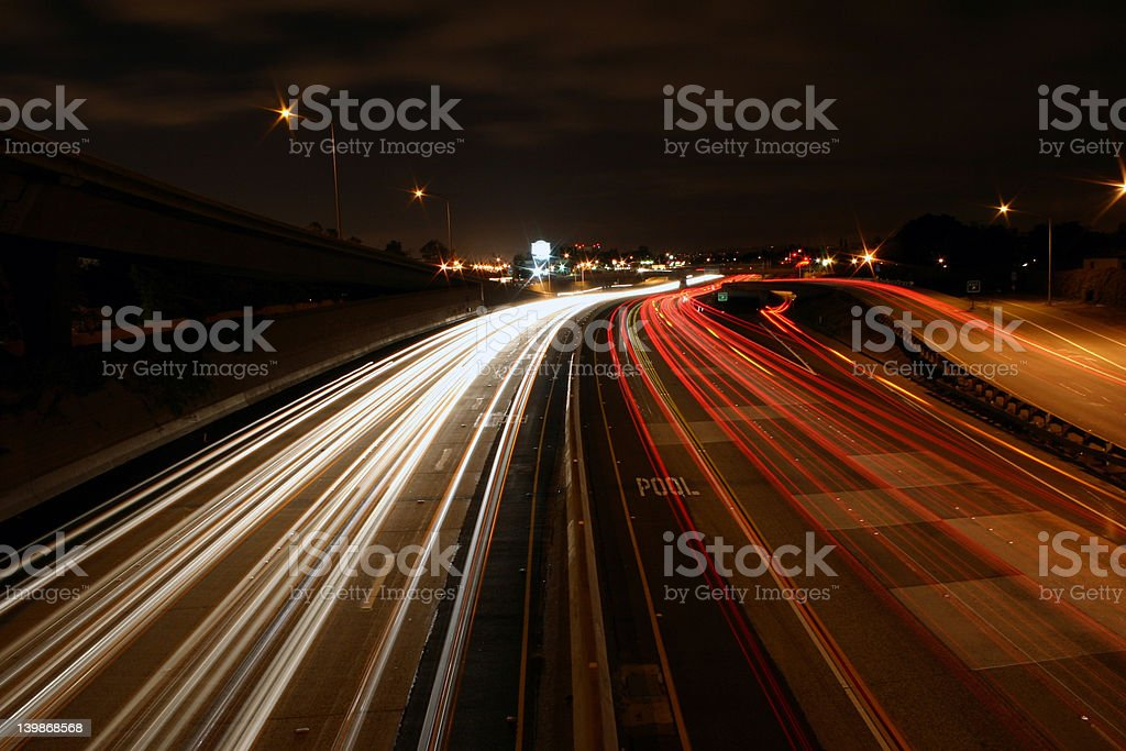 Freeway with busy traffic at night royalty-free stock photo